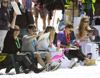 Five judges rated each of the 75 pond skimming participants, scoring them based on costume, crossing style and wipeouts.