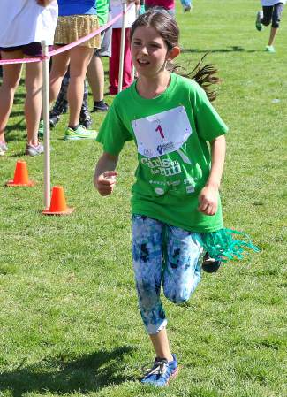 A young participant in the Girls on the Run 5K at River View Sports Park.