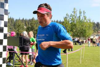 Truckee's Donatas Ereminas crosses the finish line in second place after running 13.1 miles in the Truckee Running Festival half marathon Saturday.