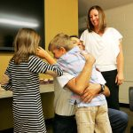 Ryan Sommers' son Andrew gives his dad a hug after he was named the newest Incline Village fire chief.