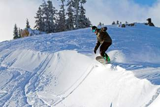 A snowboarder enjoys fresh snow at Sugar Bowl Resort at Donner Summit.