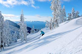 A skier carves down the wintry slopes at Diamond Peak on Dec. 23, with Lake Tahoe glimmering in the background.