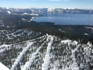 Bird's-Eye View: The backside of Northstar California, with Diamond Peak and Lake Tahoe pictured in the background.