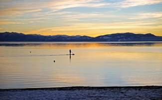 Peaceful Paddle: A lone paddleboarder enjoys the sunset off of Ski Beach in Incline Village.