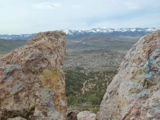 Valley View: The Carson Valley and Mt. Rose Ski Tahoe are framed between rocks on the climb up to Virginia City.