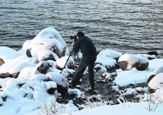 Getting the Shot: Ever wonder how Truckee photographer Chris Turner captures his amazing images? By putting in work in sub-freezing temperatures, if need be. Here he is early Tuesday morning on Donner Lake.