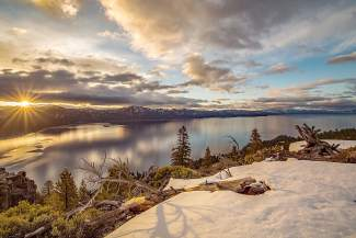 The rising sun shines over Lake Tahoe's Crystal Bay in March of this year.