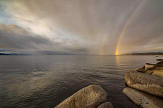 Double 'Bow: Rainbows touch down on Lake Tahoe after a rain.