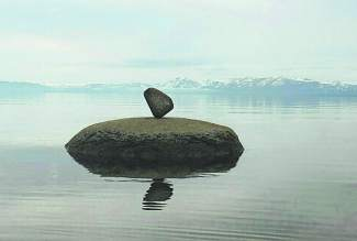 Balancing Act: A rock seems to defy physics off of Kings Beach State Beach last Wednesday.