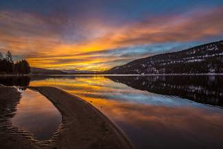 Donner the Beautiful: A vibrant sunrise reflects on Donner Lake.