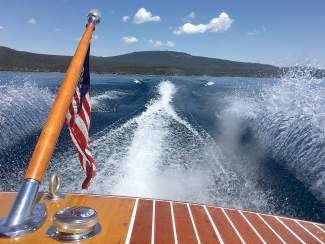 Michael Monroe skims atop Lake Tahoe on his 1959 Chris Craft wooden boat during a late-May summery day.