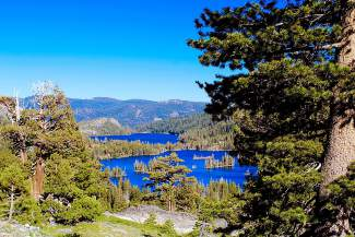 Shimmering Splendor: Upper Echo Lake glistens in the sun in mid-July, as seen from the Echo Lakes Trail near South Lake Tahoe.