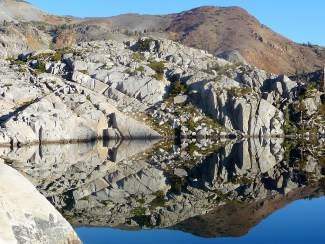 Regal Reflection: Lake Laconte, located within Desolation Wilderness, makes an arrow-like reflection in the sun.