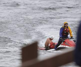 Some participants of the annual Gar Woods Polar Bear Swim had to be pulled out Lake Tahoe, which had a water temperature of 44 degrees during the event.