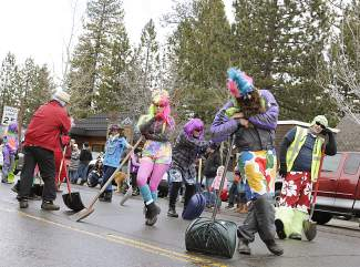 Kiwanis Precision Snow Shovel Drill Team as it performs a choreographed routine in the Tahoe City SnowFest! Parade.