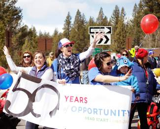 Officials, parents and children involved in Head Start march in Kings Beach SnowFest! Parade.