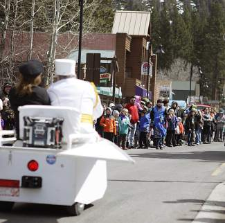 The crowd that gathered for Saturday's Kings Beach SnowFest! Parade watches as a float travels down Highway 28.