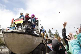 Children in the crowd during Saturday's Kings Beach SnowFest! Parade stretch out their hands in hopes of catching candy being thrown for a passing float.