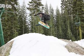 Pat Quinn, aka the Goblin, launches over a half snow-covered rock during the 7th Annual Minus 7 Melee at Donner Ski Ranch. Quinn won Best Trick.