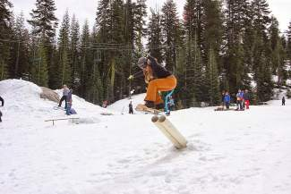 Kendra Wilson shoots off the cannon rail jump during the 7th Annual Minus 7 Melee at Donner Ski Ranch on Saturday.