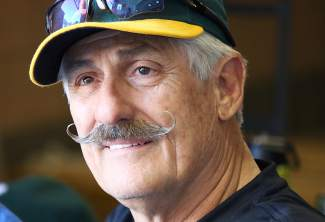 A's Hall of Famer Rollie Ringers was on hand to sign autographs during a Spring Training game in Mesa.