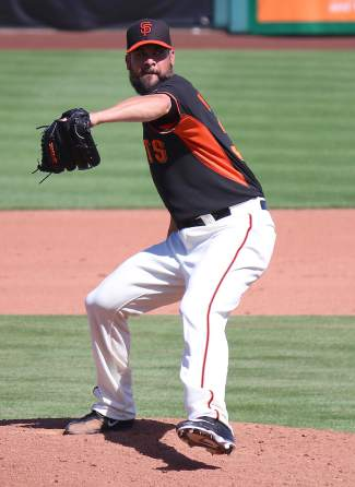 The Giants' Ryan Vogelsong pitches in a Spring Training game against the Dodgers in Scottsdale.