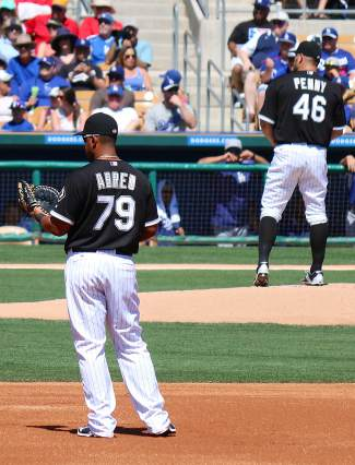 Rising White Sox star Jose Abreu and veteran pitcher Brad Penny are pictured in a Spring Training game against the Dodgers.