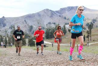 A group nears the finish of the Squaw Mountain Run on Saturday.