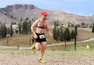 Olympic Nordic skier Brian Gregg of Minnesota races to a first-place finish in the Squaw Mountain Run on Saturday.