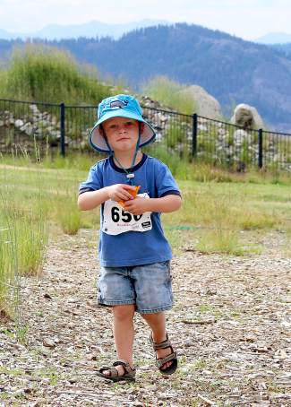 A young Squaw Mountain Run attendee scores a handful of chips during Saturday's race.