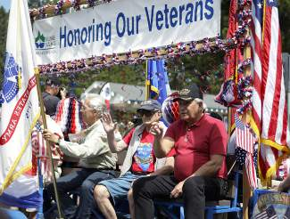 Veterans ride on a float in