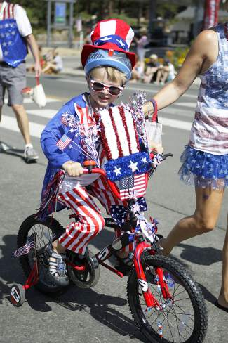 Dressed as Uncle Sam, this boy was part of the Kid's Bike Parade on Friday morning along Tahoe Boulevard.