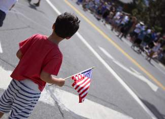 A boy holds the American flag during Friday's