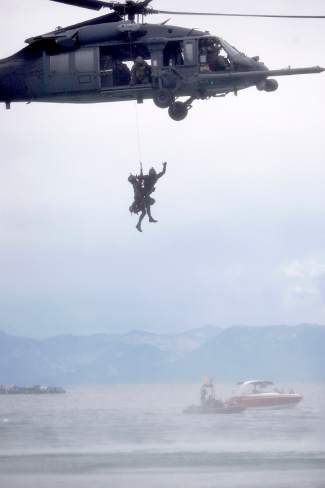 A U.S. Air Force helicopter lifts rescue squadron members out of the waters of Lake Tahoe as part of a search and rescue demonstration Saturday afternoon off the shores of Incline Beach.