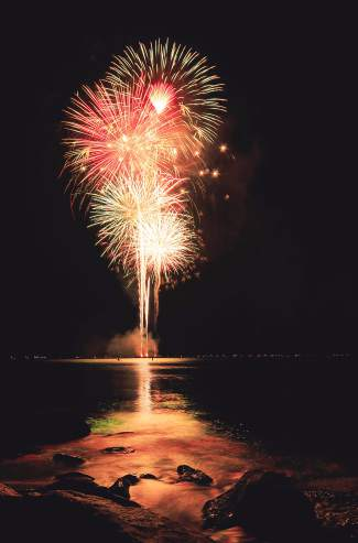 Fireworks explode over Lake Tahoe off Incline Beach Saturday night.