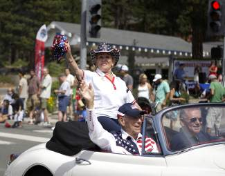 From left, Joyce and Charlie Anderson Bock, parade grand marshals, wave to the hundreds of people lining Tahoe Boulevard for Friday morning's parade.