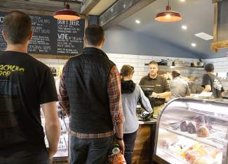 The market has a deli counter, where handmade sandwiches, prepared salads and on-tap beer can be purchased.