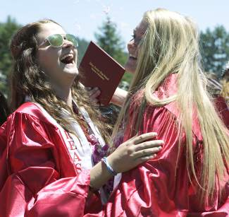 From left, Nichole Graham and Sarah Svoboda celebrate after graduating from Truckee High School on Saturday.