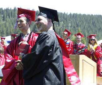 Truckee High School graduate Brandon Flora accepts his diploma from science teacher Kirby Reed at Saturday's commencement ceremony.