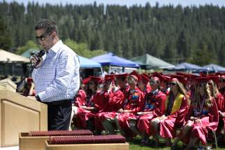 Larry Harper, founder of the Good Tidings Foundation, addresses Truckee High School's 139 graduating students and their family and friends Saturday morning at graduation