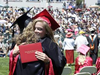 Truckee High School graduate Katherine Englert hugs math teacher Jody  Burrill during Saturday's graduation ceremony.