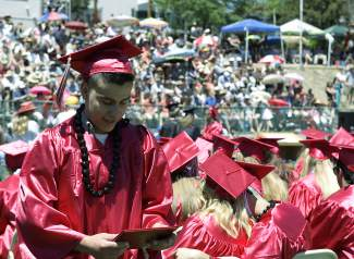 Truckee High School graduate Marco Padiila looks at diploma shortly after receiving it.
