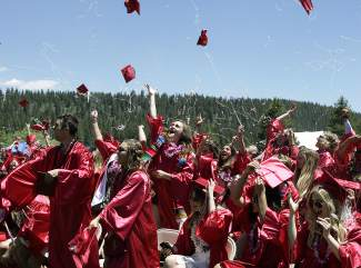 Students in Truckee High School's class of 2015 throw their caps in the air at the end of Saturday's graduation ceremony at Surprise Stadium.
