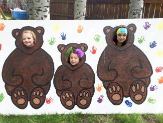 Shelby Erikson and Genevieve and Guiliana Phung had a fun time at Sunday's Teddy Bear Picnic at Aspen Grove.