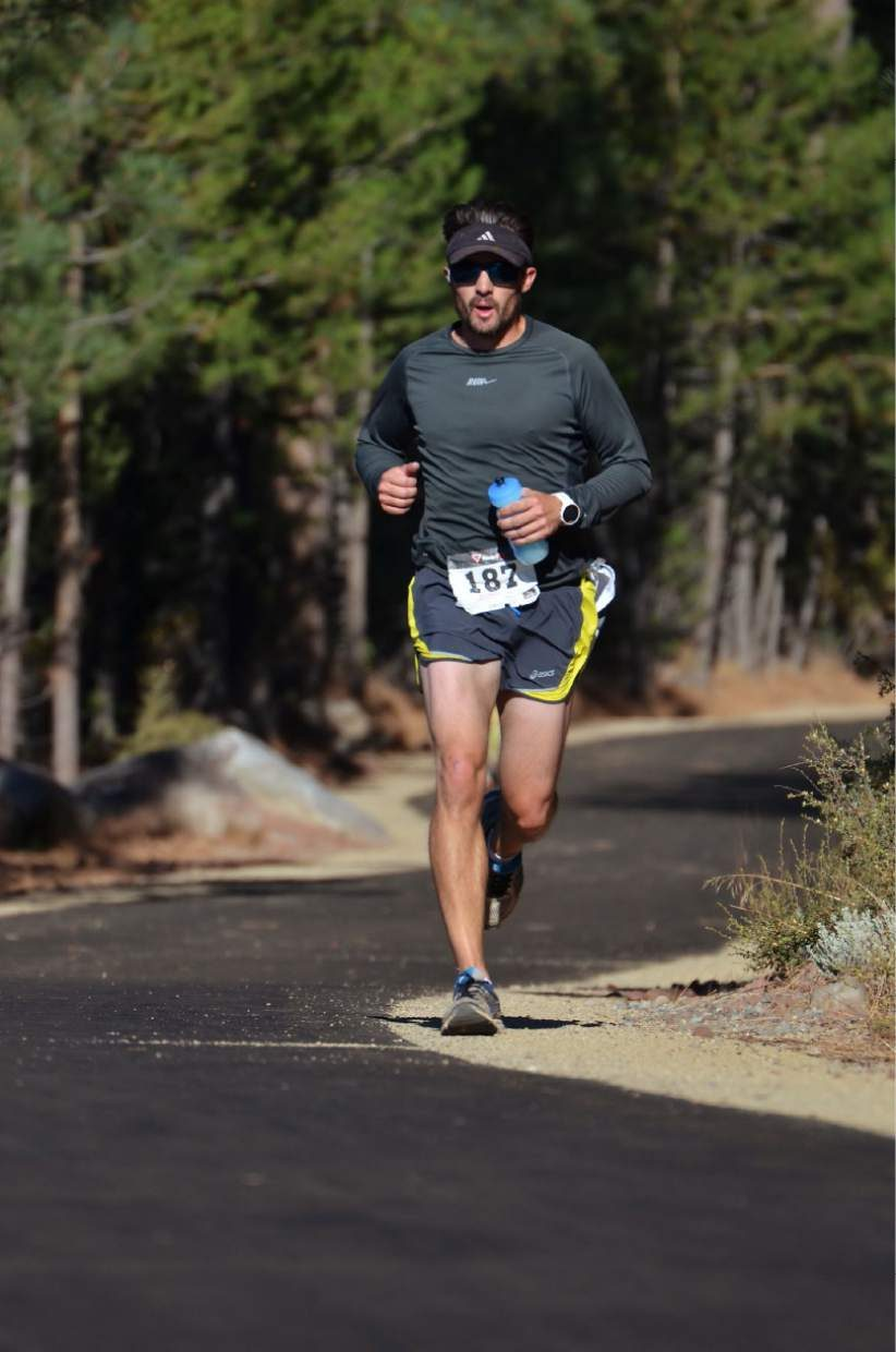 Robert McClendon of Truckee, eighth overall in the marathon, heads down the new Trout Creek Trail, about one and a half miles from the midway point.