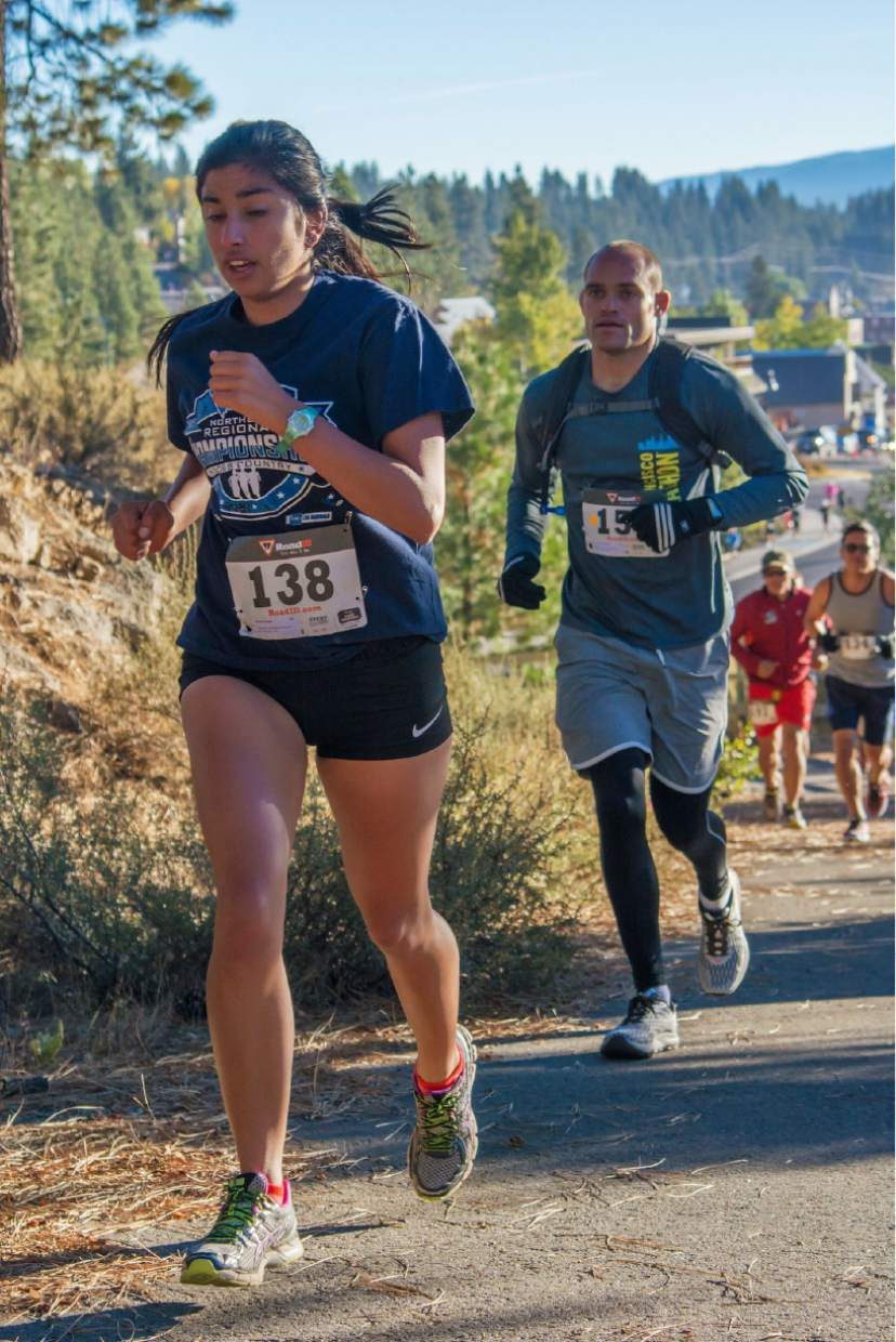 Rachel Rezaei of South Lake Tahoe, 20th overall in the half marathon, and Robert Schwartz of Truckee, third in the marathon, climb the hill toward the Sierra College campus.