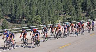 The Men's 15-16 pack crosses the Highway 267 Bypass over the Truckee River on their way from Loyalton to Northstar Wednesday morning. The Road race, a longer format requiring endurance and strategy, was the first event in this week's USA Cycling National Championships.