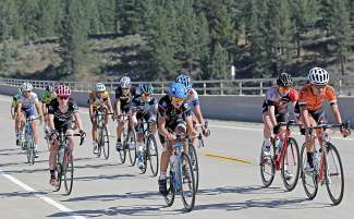 Riders in the Men's 15-16 age group cross the Highway 267 Bypass in the final 10 Kilometers of the Road Race from Loyalton to Northstar Wednesday morning. Despite being on different teams, riders strategically work together to draft for the most speed and efficiency.
