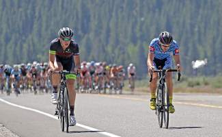 Two riders break away from the pack early in the Men's 17-18 age group Road Race from Northstar to Loyalton and back again Wednesday morning in the Martis Valley. Breaking away early is a gamble, as the two lone riders don't have the aerodynamic advantages of riding in the bigger pack.