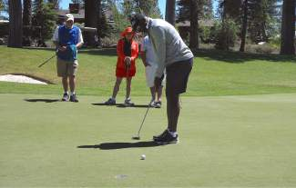 Hall of Fame wide receiver and ex-Raider Tim Brown prepares to putt during the Gene Upshaw Memorial Golf Classic.
